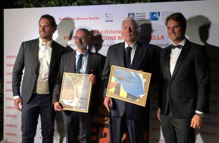 Il 19^ Premio Mimmo Rotella quest'anno premia Giuseppe Capotondi , Donald Sutherland e Mick Jagger per The Burnt Orange Heresy.